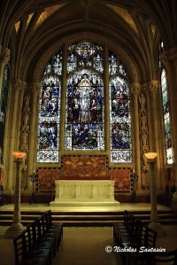 The altar in a chapel in the apse and its stained glass window.