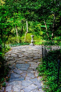 A stone walkway leading up to the sundial.